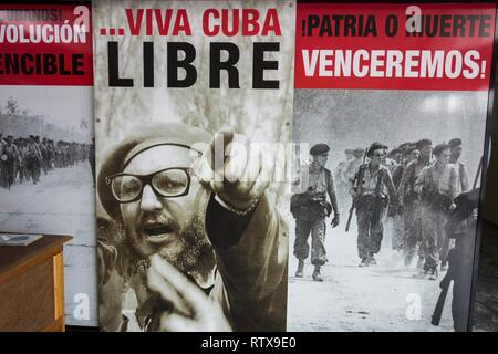 Scenes of Famous Bay of Pigs Cuban Revolution Battle and Poster of Fidel Castro on Entrance to the Museum of Playa Giron Cuba - Stock Image