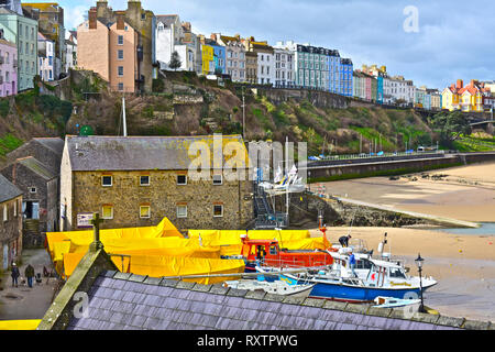 A view of the colourful houses overlooking the harbour and North Beach in the Welsh seaside resort of Tenby, S.Wales - Stock Image