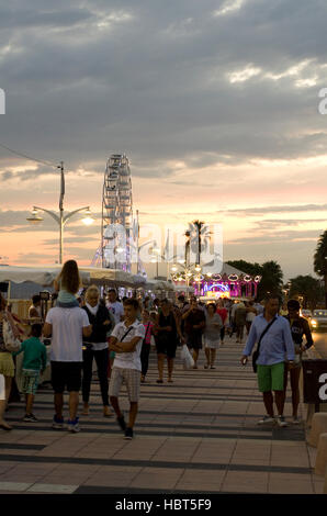 Sea front promenade and market at night in Saint-Raphaël, France. - Stock Image