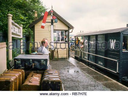 Caerphilly Railway Centre, Harold Wilson Industrial Estate, Caerphilly, Wales, UK  - guards van ride taking place on the running line, with TVR 0-6-2 and GWR Guards Van – Brecon & Merthyr Railway Rwiwderen Signal Box with McKenzie Holland signal – 1980s (1988) - Stock Image