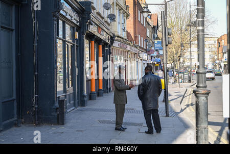 London, UK. 17th Feb, 2019.   Time for a chat on Tottenham High Road on a lovely sunny day in North London Credit: Simon Dack/Alamy Live News - Stock Image