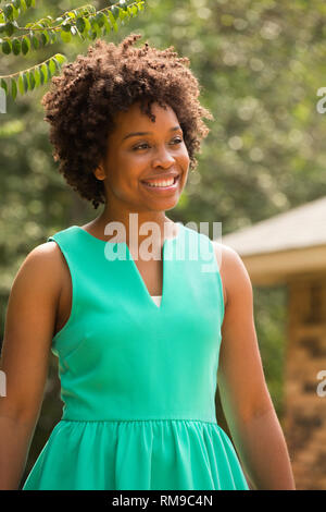 Young happy African American woman smiling. - Stock Image