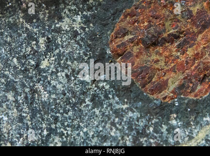 Gore Mountain garnet, giant garnet crystal surrounded by hornblende rim. The Field Museum, Chicago, Illinois, USA. - Stock Image