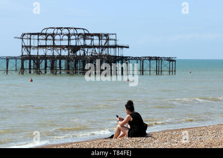 Brighton, UK. 10th May 2019. People enjoy the Friday sunshine on Brighton Beach after the weather improves after a cold bank holiday. Credit: JOHNNY ARMSTEAD/Alamy Live News - Stock Image