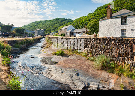 2 July 2018: Boscastle, North Cornwall, UK - the coastal village of Boscastle, with cottages and the River Valency running through it with a slate str - Stock Image