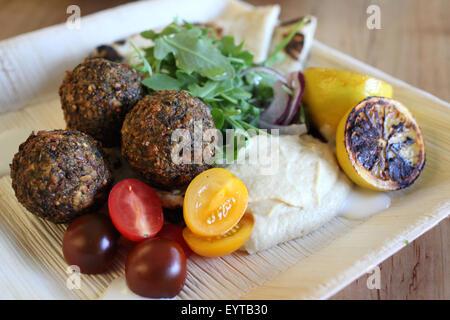 Falafel platter at a restaurant - Stock Image