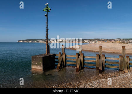 View across to Seaton over the river Axe as it reaches the sea between Axmouth and Seaton. - Stock Image