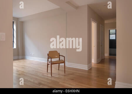 single chair in empty home room - Stock Image