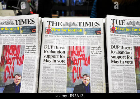 The Times newspaper headlines  'DUP threat to abandon support for May in vote' &  President Macron Paris protest article on3 December 2018 London UK - Stock Image