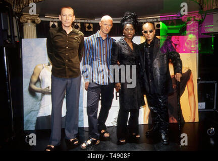M PEOPLE English dance music group with Mike Pickering at left and Heather Small about 1994 - Stock Image