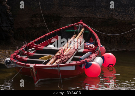 Small wooden sailing and rowing boat moored in the harbour at Ness on the Isle of Lewis - Stock Image