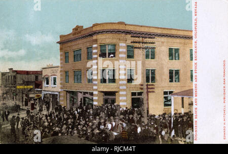 A crowd of people outside the Nixon Block and Mining and Stock Exchange, Goldfield, Nevada, USA. - Stock Image