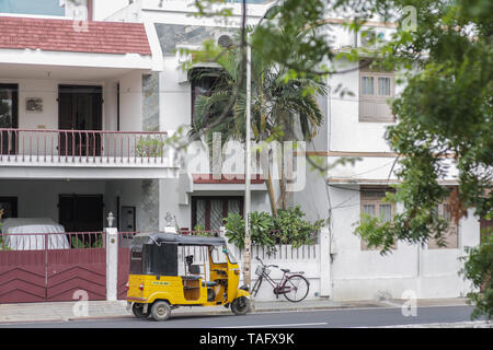 A parked auto rickshaw in front of a house on a street in the former french colony of Pondicherry - Stock Image