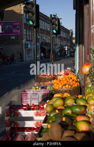food, wine and fruit for sale on stoke newington church street on a bright, sunny day in london - Stock Image