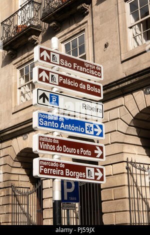 Portugal, Porto, Ribeira, Rua do Infante D Henrique, road sign to tourist attractions - Stock Image