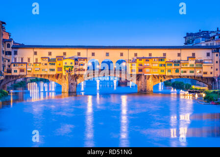 Florence, Tuscany - Ponte Vecchio and Palazzo Vecchio at night, Renaissance architecture in Italy. - Stock Image