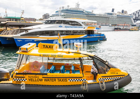 Water taxi, Manly fast ferry and cruise ship Celebrity Solstice all at Circular Quay harbour in Sydney ,Australia - Stock Image