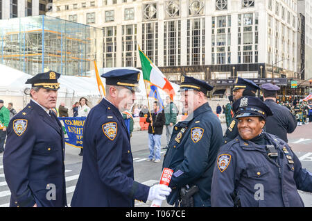 New York City, USA. 16th Mar, 2019. Police department officials also enjoy St. Patrick's day parade along 5th Avenue. Credit: jbdodane/Alamy Live News - Stock Image