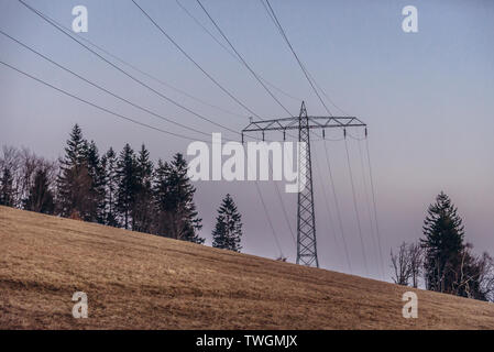 Electricity pylon on Wielka Sowa (Great Owl) mount in Landscape Park of Gory Sowie (Owl Mountains range) in Central Sudetes, Poland - Stock Image