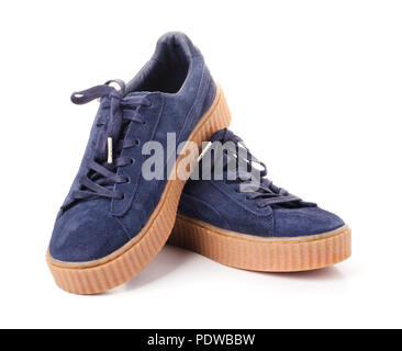 Blue sneakers on high soles in gray and blue isolated on a white background - Stock Image
