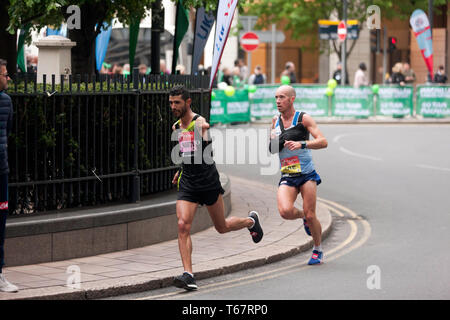 Abdelhadi  El Harti (MAR),  and Derek Rae (GBR), competing in the 2019 London Marathon they went on to finish 7th and 5th in times of 02:30:44 and 02:27:08 respectively. (3rd and 2nd in the T45/46 Category) - Stock Image