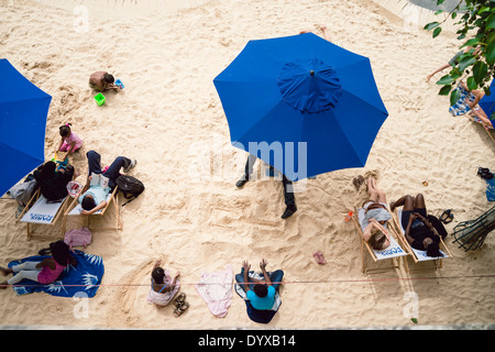 Top view of people enjoying the artificial beach built on the banks of the Seine river in the city of Paris, France. - Stock Image