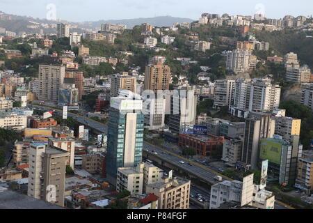 Colinas de Bello Monte and Valle Arriba from the Sabana Grande Business District in Caracas Venezuela. Marcos Kirschstein and Vicente Quintero. 2018 - Stock Image