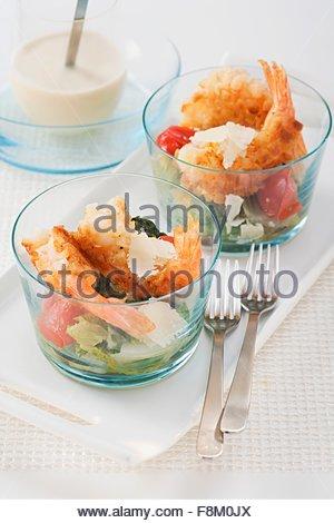 Caesar salad with crispy prawns - Stock Image