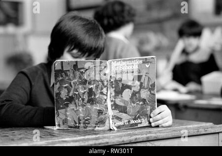 Education: Lack of text books in the early 1980's led to school children having to share books. Books were repaired many times and were only replaced when they could not be read. March 1981 PM 81-01143-002 - Stock Image