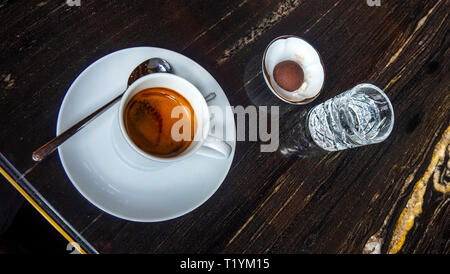 Espresso coffee in a white cup and saucer. - Stock Image