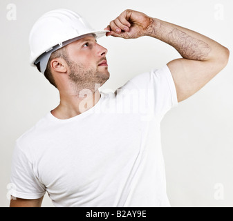 engineer with hard hat on isolated background - Stock Image