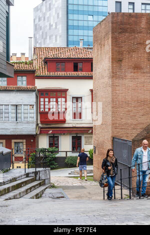 Gijon, Spain - 6th July 2018: People walking up steps in the old fishermans quarter. The area is known as Cimadevilla - Stock Image