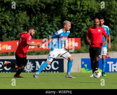 Stadium Carciato, Dimaro, Italy. 13th July, 2019. Pre-season football freindly, Napoli versus Benevento; Gianluca Gaetano of Napoli challenged by Giovanni Volpicelli of Benevento Credit: Action Plus Sports/Alamy Live News - Stock Image