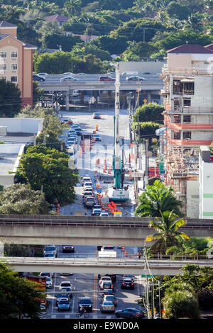 Metrorail and Metromover elevated tracks, traffic and road construction on Coral Way in downtown Brickell, Miami, - Stock Image