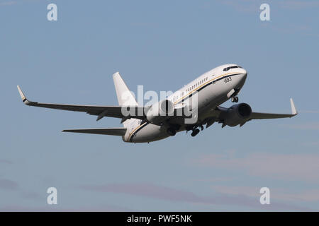 Boeing C-40A Clipper climbing out of RAF Mildenhall whilst working a cargo flight for the US Navy. - Stock Image