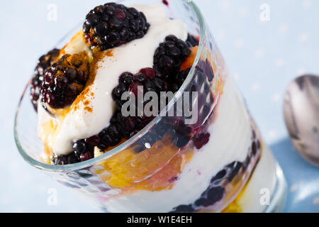Blackberry and orange yoghurt - delicious summer dessert - Stock Image