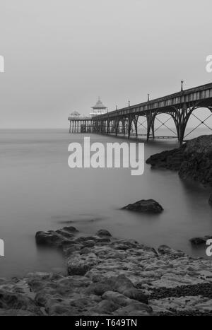 Reaching out into the Severn esturay the Victorian Pleasure Pier of Clevedon Somerset England UK. April 2019. - Stock Image