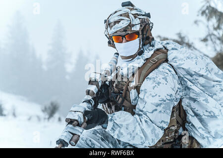 Winter arctic mountains warfare. - Stock Image