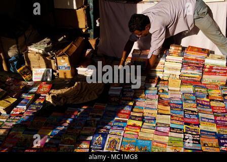 Variety Language Magazines and Books selling Man in street markets of Bhubaneswar Odisha India - Stock Image
