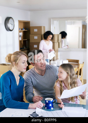 Working from home family take a break - Stock Image