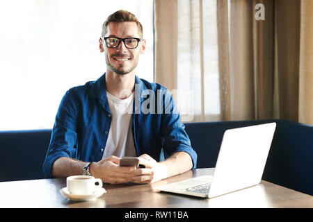 Guy with gadgets - Stock Image