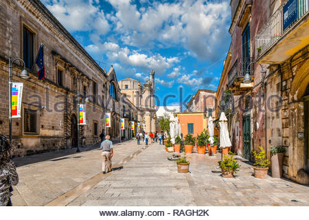 Tourists and locals walk the Via Domenico Ridola towards the Purgatory Church in the newer section of Matera Italy, in the Basilicata Region. - Stock Image