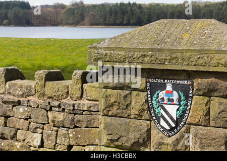 Bolton Corporation Waterworks shield on the wall outside the old outlet tower on the dam at Turton and Entwistle - Stock Image