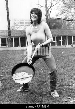 Suzanne Danielle in great form before taking part in a pancake race, 23rd February 1982. - Stock Image