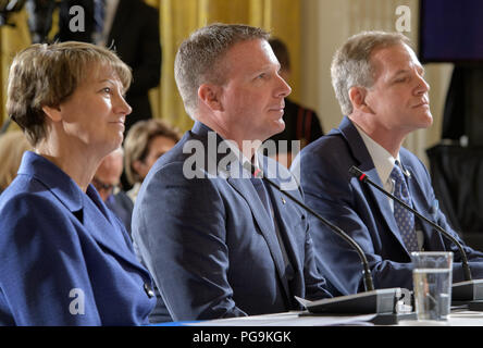 Former NASA astronauts Eileen Collins, left, Terry Virts, center, and Scott Parazynski are seen during a meeting of the National Space Council in the East Room of the White House, Monday, June 18, 2018, in Washington. Chaired by the Vice President, the council's role is to advise the President regarding national space policy and strategy, and review the nation's long-range goals for space activities. - Stock Image