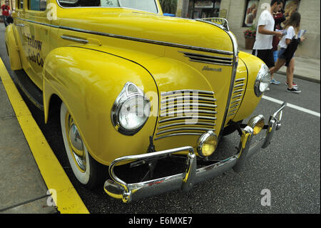 Vintage Chrysler Plymouth Yellow cab taxi, Universal Orlando Resort, Orlando, Florida, USA - Stock Image