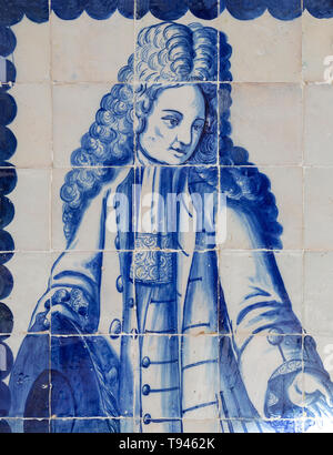 Blue and white azulejo tiles fashionable Portuguese gentleman in eighteenth century, University of Evora, Portugal - Stock Image