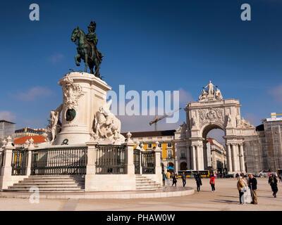 Portugal, Lisbon, Praco de Comecio, statue of Dom Jose I in middle of square towards Rua Augusta Arch - Stock Image