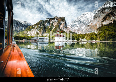 boat drive on the Königssee in Berchtesgaden in Germany Bavaria. a very beautiful lake with reflecting mountains in the water during Spring - Stock Image