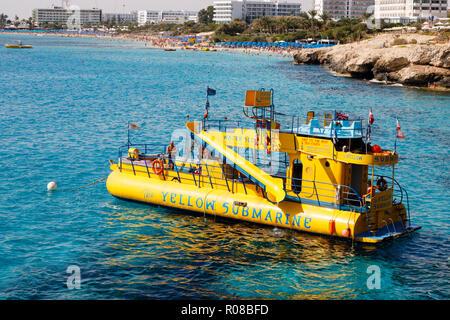 Yellow submarine pleasure boat at the Love Bridge, Ayia Napa, Cyprus October 2018 - Stock Image